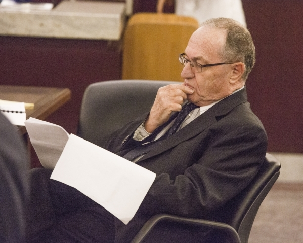 Renowned Harvard University law professor Alan Dershowitz, representing Las Sands reads briefs before before appearing in front of the Nevada Supreme Court at the Regional Justice Center on Tuesda ...