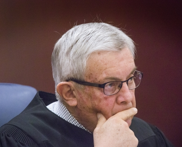 Justice James Hardesty listens while Harvard University law professor Alan Dershowitz, representing Las Vegas Sands, appears in front of the Nevada Supreme Court at the Regional Justice Center on  ...