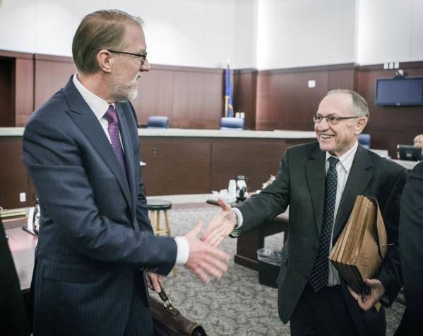Todd Bice, left, representing Richard Suen, and Harvard University law professor Alan Dershowitz, representing Las Vegas Sands, left, shake hands after appearing in front of the Nevada Supreme Cou ...