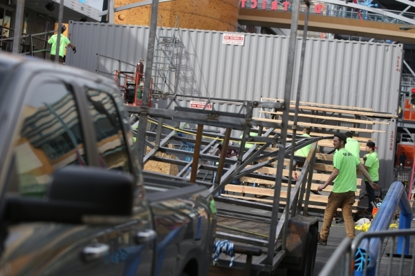 Workers construct a snowboarding course on Fremont Street near Las Vegas Boulevard in preparation for the Park Jam snowboard competition on Friday, Jan. 22, 2016, in Las Vegas. The Saturday night  ...