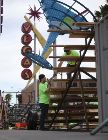 Workers build a staircase as part of a snowboarding course on Fremont Street near Las Vegas Boulevard in preparation for the Park Jam snowboard competition on Friday, Jan. 22, 2016, in Las Vegas.  ...