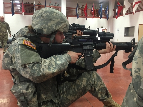 Nevada Army National Guard soldiers from the 422nd Expeditionary Signal Battalion aim their weapons Thursday, Jan. 21, 2016, during mobilization training at the Clark County Armory. Keith Rogers/L ...