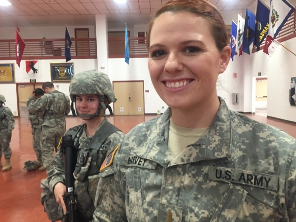 Nevada Army National Guard Spc. Larissa Givens, left, 20, of Reno, poses with 2nd Lt. Allison Harvey of the 422nd Expeditionary Signal Battalion during a break in training, Thursday, Jan. 21, 2016 ...
