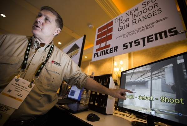 Pierce English with Plinker Electronic Target Systems speaks about the shooting sport during the Shot Show at the Sands Expo on Wednesday, Jan. 20, 2016. (Jeff Scheid/Las Vegas Review-Journal Foll ...