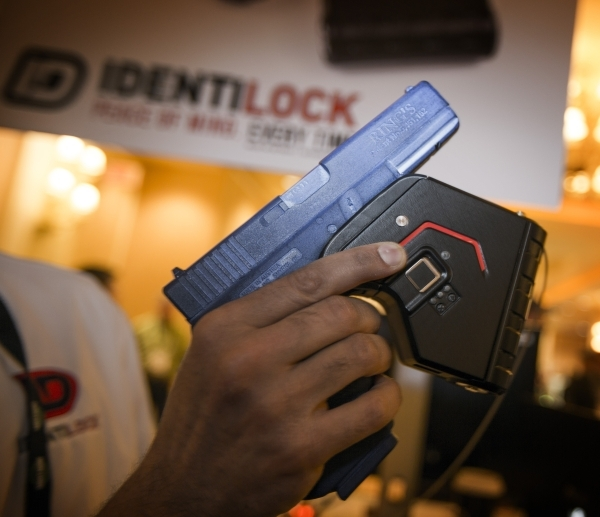 Omer Kiyani, founder of Identilock, holds the  gun lock he created during the Shot Show at the Sands Expo on Wednesday, Jan. 20, 2016. The biometric gunlock reads the shooter's finger prints ...