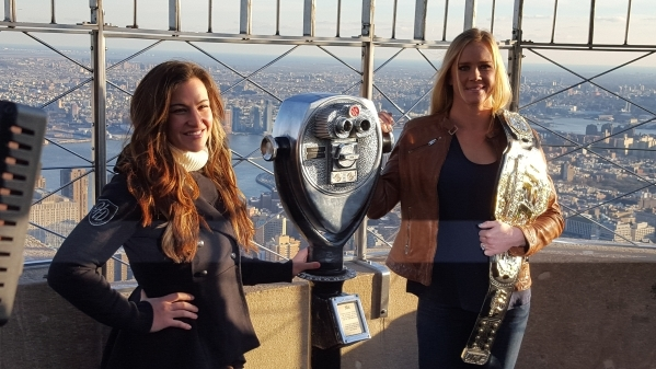 Miesha Tate, left, and Ultimate Fighting Championship women's bantamweight champion Holly Holm pose for a picture on the observation deck of the Empire State Building during a media tour in  ...