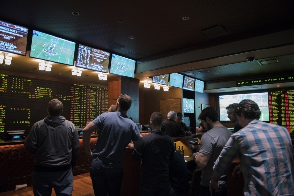 Betters wait for the opening line on the Super Bowl at the Golden Nugget hotel-casino sports book in Downtown Las Vegas on Sunday Jan 24, 2015. The Carolina Panthers are a -4 favorite to win Super ...