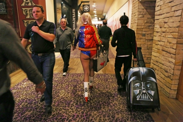 People walk through the hallway outside the AVN Adult Entertainment Expo 2016 at Hard Rock hotel-casino Friday, Jan. 22, 2016, in Las Vegas. The four-day expo featured adult entertainers, merchand ...