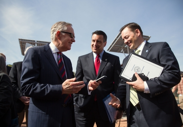 "Harry Reid, left, Gov. Brian Sandoval, center, and Paul Thomsen, Director of the Nevada Office of Energy, talk March 20, 2014, in front of solar trees at the ""Welcome to Fabulous Las Vegas&qu ..."