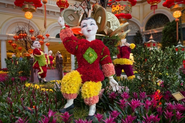 Six topiaries in the shape of Chinese children -- each made from 5,000 flower stems -- welcome visitors to Bellagio's Conservatory and Botanical Gardens, which celebrates Chinese New Year wi ...