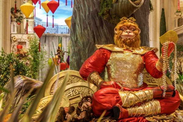 At The Venetian and Palazzo's Waterfall Atrium and Gardens, a 5-foot, 300-pound Monkey King -- sporting a chest plate made of more than 8,000 gold coins -- holds court through February in ce ...