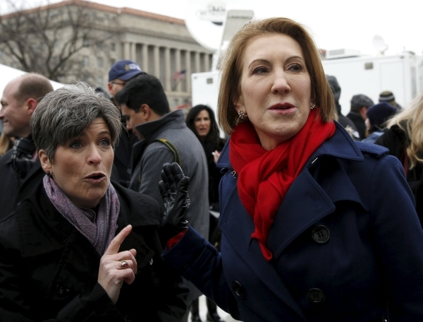 Republican presidential candidate Carly Fiorina (R) and Senator Joni Ernst (R-IA) (L) chat backstage at the National March for Life rally in Washington January 22, 2016. The rally marks the 43rd a ...