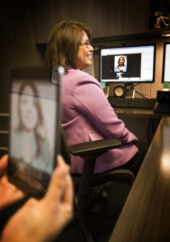 Fe Allen, director of talent acquisition for MGM Resorts, and Cristina Palafox, MGM Grand human resource associate, image on tablet, demonstrates the virtual interview at the corporate office, 840 ...