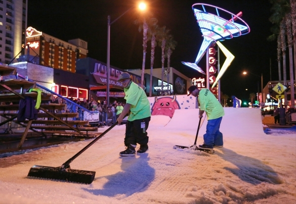 Workers prepare the track before the 2016 Park Jam snowboarding competition on Fremont Street in Las Vegas on Saturday, Jan. 23, 2016. Brett Le Blanc/Las Vegas Review-Journal Follow @bleblancphoto