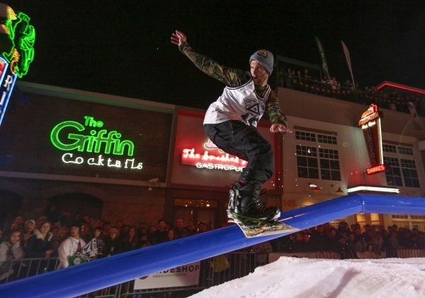 A snowboarder grinds down a rail during the 2016 Park Jam snowboarding competition on Fremont Street in Las Vegas on Saturday, Jan. 23, 2016. Brett Le Blanc/Las Vegas Review-Journal Follow @blebla ...