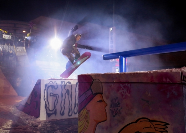 A snowboarder jumps from a ramp to a rail during the 2016 Park Jam snowboarding competition on Fremont Street in Las Vegas on Saturday, Jan. 23, 2016. Brett Le Blanc/Las Vegas Review-Journal Follo ...