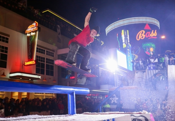A snowboarder jumps to a rail during the 2016 Park Jam snowboarding competition on Fremont Street in Las Vegas on Saturday, Jan. 23, 2016. Brett Le Blanc/Las Vegas Review-Journal Follow @bleblancphoto