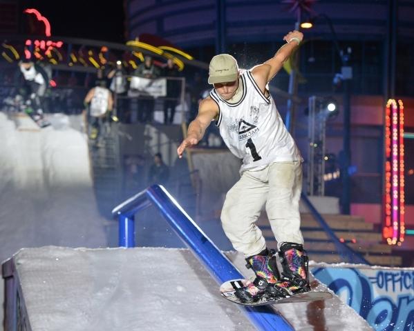 A contestant grinds down a rail during the 2016 Park Jam snowboarding competition on Fremont Street in Las Vegas on Saturday, Jan. 23, 2016. Brett Le Blanc/Las Vegas Review-Journal Follow @bleblan ...