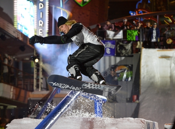 A snowboarder jumps into a rail slide during the 2016 Park Jam snowboarding competition on Fremont Street in Las Vegas on Saturday, Jan. 23, 2016. Brett Le Blanc/Las Vegas Review-Journal Follow @b ...