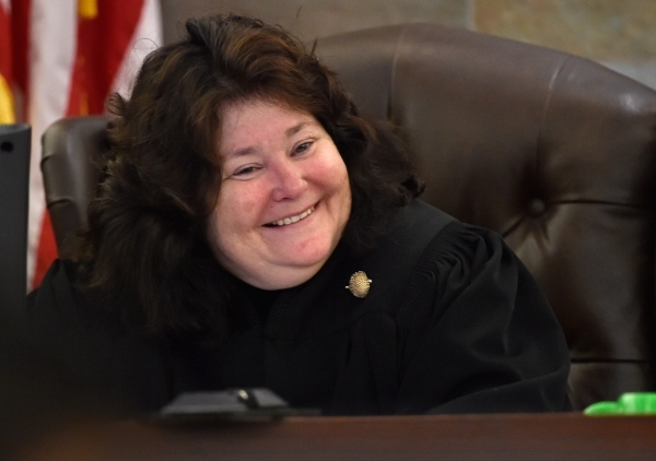 District Court Judge Elizabeth Gonzalez smiles during the wrongful termination case of former Sands Macau President Steven Jacobs on May 1, 2015, at the Clark County Justice Center in Las Vegas. L ...
