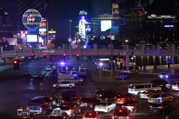 Strip traffic is detoured as Las Vegas police investigate a shooting along Las Vegas Boulevard in front the of the Bellagio hotel-casino on Friday, Jan. 22, 2016, in Las Vegas. David Becker/Las Ve ...