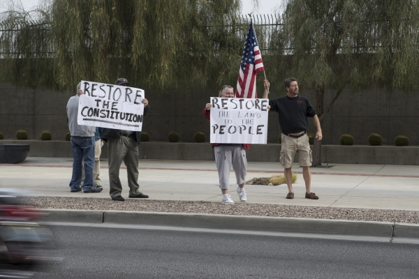 """Bundy family supporters rally in support of what they call """"victims of federal oppression"""" outside of the Lloyd George U.S. Courthouse on Saturday, Jan. 23, 2016, in Las Vegas. Erik Verd ..."""