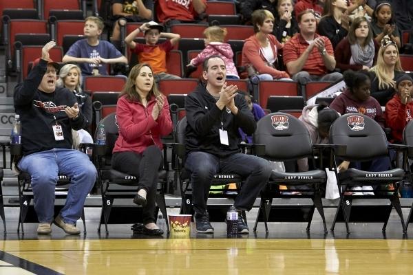 UNLV fans, from lef,t Walt Irvine, Cheryl Shea and Jeff Shea cheer from Cox Pavilion courtside seats at Lady Rebels vs. UNR women's basketball game on Jan. 23, 2016. (R. Marsh Starks/UNLV Ph ...