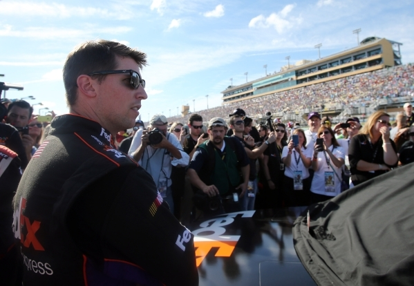 Nov 16, 2014; Homestead, FL, USA; NASCAR Sprint Cup Series driver Denny Hamlin prior to the Ford EcoBoost 400 at Homestead-Miami Speedway. Mandatory Credit: Jerry Lai-USA TODAY Sports - RTR4ECW2