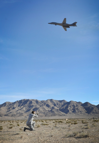 Air Force Sgt. Thomas Spangler photographs a B-1 Lancer after taking off from Nellis Air Force Base during a Red Flag exercise on Monday, Jan. 25, 2016, in Las Vegas. More than 80 warplanes from s ...