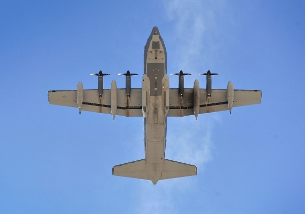 A C-130 flies overhead after taking off during a Red Flag exercise at Nellis Air Force Base on Monday, Jan. 25, 2016, in Las Vegas. More than 80 warplanes from squadrons in the United States, Unit ...