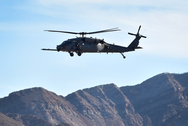 An HH60 Pavehawk helicopter flies overhead after taking off during a Red Flag exercise at Nellis Air Force Base on Monday, Jan. 25, 2016, in Las Vegas. More than 80 warplanes from squadrons in the ...