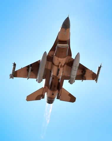 An F-16 fighter jet with its after-burner aglow flies overhead after taking off from Nellis Air Force Base during a Red Flag exercise on Monday, Jan. 25, 2016, in Las Vegas. More than 80 warplanes ...