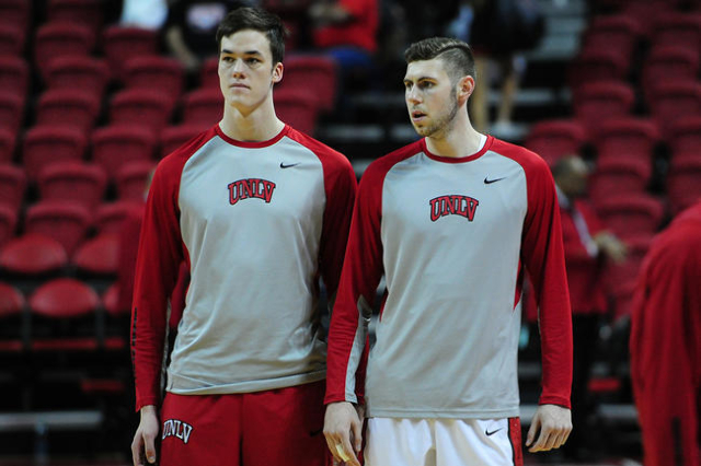 UNLV forwards Stephen Zimmerman Jr., left,  and Ben Carter are seen before the start of their NCAA college basketball game against San Diego State at the Thomas & Mack Center in Las Vegas Satu ...