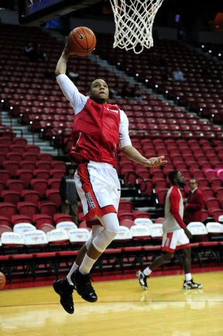 UNLV guard Jalen Poyser goes up for a dunk during warm-ups before the start of their NCAA college basketball game against San Diego State at the Thomas & Mack Center in Las Vegas Saturday, Jan ...