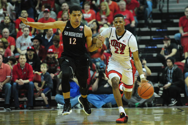UNLV guard Patrick McCaw (22) dribbles the ball up-court while San Diego State guard Trey Kell (12) defends in the first half of their NCAA college basketball game at the Thomas & Mack Center  ...