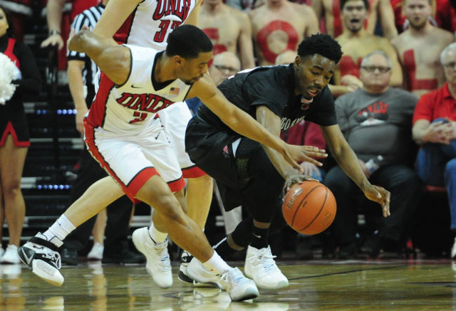 UNLV guard Jerome Seagears (2) and San Diego State guard Jeremy Hemsley (4) battle for a loose ball in the first half of their NCAA college basketball game at the Thomas & Mack Center in Las V ...