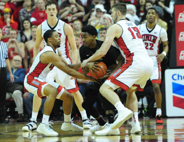UNLV guard Jerome Seagears (2), forward Ben Carter (13) and San Diego State guard Jeremy Hemsley (4) battle for a for the ball in the first half of their NCAA college basketball game at the Thomas ...