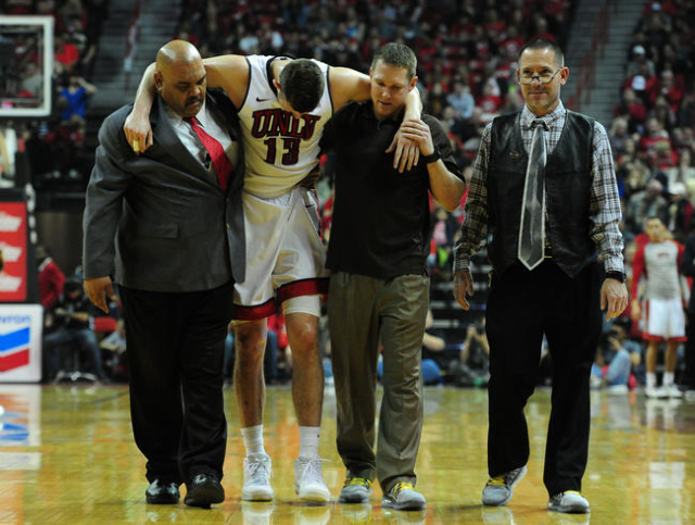 UNLV forward Ben Carter (13) is carried off the floor in the first half of their NCAA college basketball game against San Diego State at the Thomas & Mack Center in Las Vegas Saturday, Jan. 30 ...