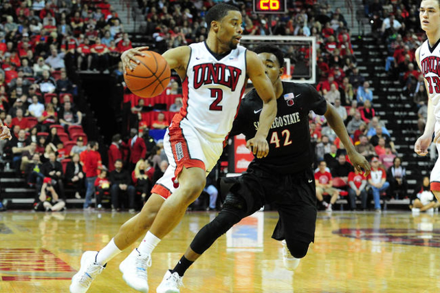 UNLV guard Jerome Seagears (2) drives to the basket while San Diego State guard Jeremy Hemsley (42) defends in the second half of their NCAA college basketball game against San Diego State at the  ...