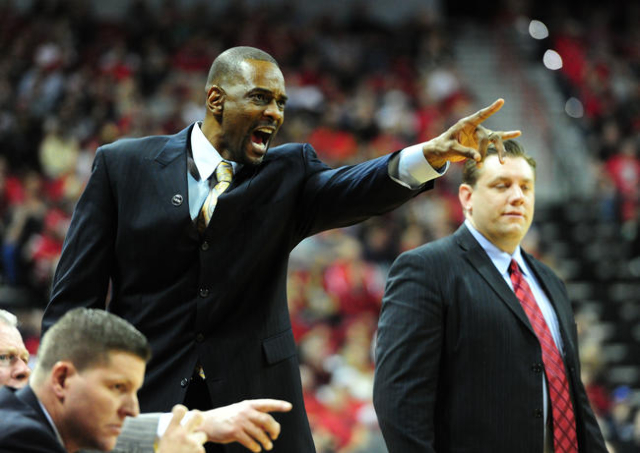UNLV assistant head coach Stacey Augmon is seen in the second half of their NCAA college basketball game against San Diego State at the Thomas & Mack Center in Las Vegas Saturday, Jan. 30, 201 ...