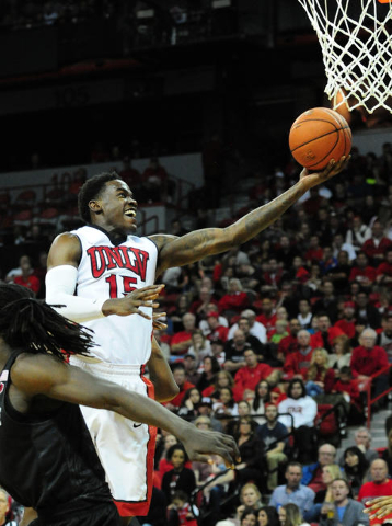 UNLV forward Dwayne Morgan (15) goes up for a shot against San Diego State in the second half of their NCAA college basketball game  at the Thomas & Mack Center in Las Vegas Saturday, Jan. 30, ...