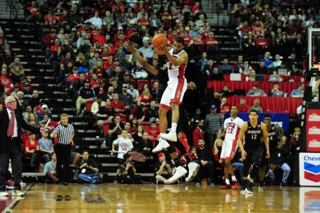 UNLV guard Jerome Seagears (2) goes up high to catch an inbounds pass against San Diego State guard Jeremy Hemsley (42) in the second half of their NCAA college basketball game at the Thomas & ...