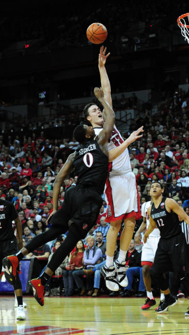 UNLV forward Stephen Zimmerman Jr. (33) goes up for a shot against San Diego State forward Skylar Spencer (0) in the second half of their NCAA college basketball game at the Thomas & Mack Cent ...