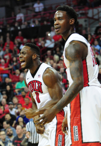 UNLV guard Ike Nwamu (0) and forward Dwayne Morgan, right, react to a foul called against UNLV in the second half of their NCAA college basketball game against San Diego Sate at the Thomas & M ...