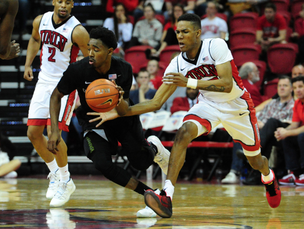 San Diego State guard Jeremy Hemsley, left, slips past UNLV guard Patrick McCaw (22) in the second half of their NCAA college basketball game at the Thomas & Mack Center in Las Vegas Saturday, ...
