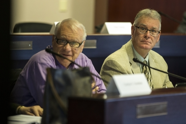 Dr. Larry Moses, left, and Henderson Mayor Andy Hafen, look at a presentation during a technical committee meeting to discuss the reorganization of the Clark County School District at the Grant Sa ...