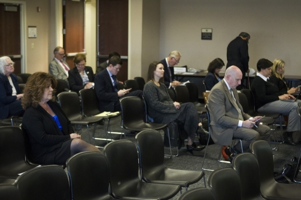 People listen during a technical committee meeting to discuss the reorganization of the Clark County School District at the Grant Sawyer State Office Building on Wednesday, Jan. 27, 2016, in Las V ...