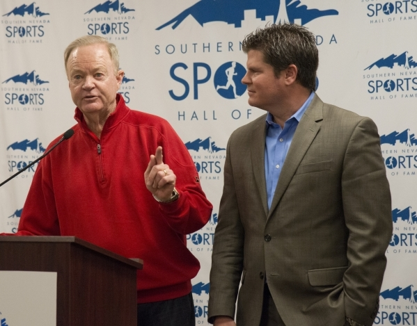 The coach of the 1998 UNLV golf team, Dwaine Knight, left, and a player from that team, Jeremy Anderson, speak after their team is announced as an inductee of the Southern Nevada Sports Hall of Fa ...