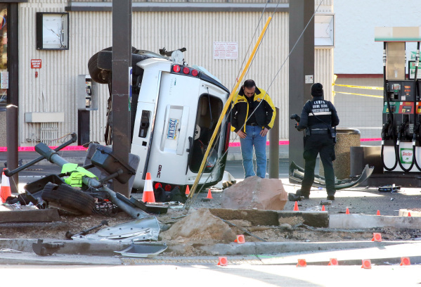 Metro Police are investigating a fatal crash where a woman died and another is hospitalized with life-threatening injuries in the intersection of Spring Mountain Road and Rainbow Boulevard, when t ...