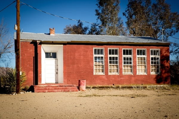 In the center of the site is Freeman Hall, a former schoolhouse approximately 20-feet-by-25-feet with a galvanized steel roof, fluorescent lights in the vaulted ceiling and a pinewood floor. No lo ...